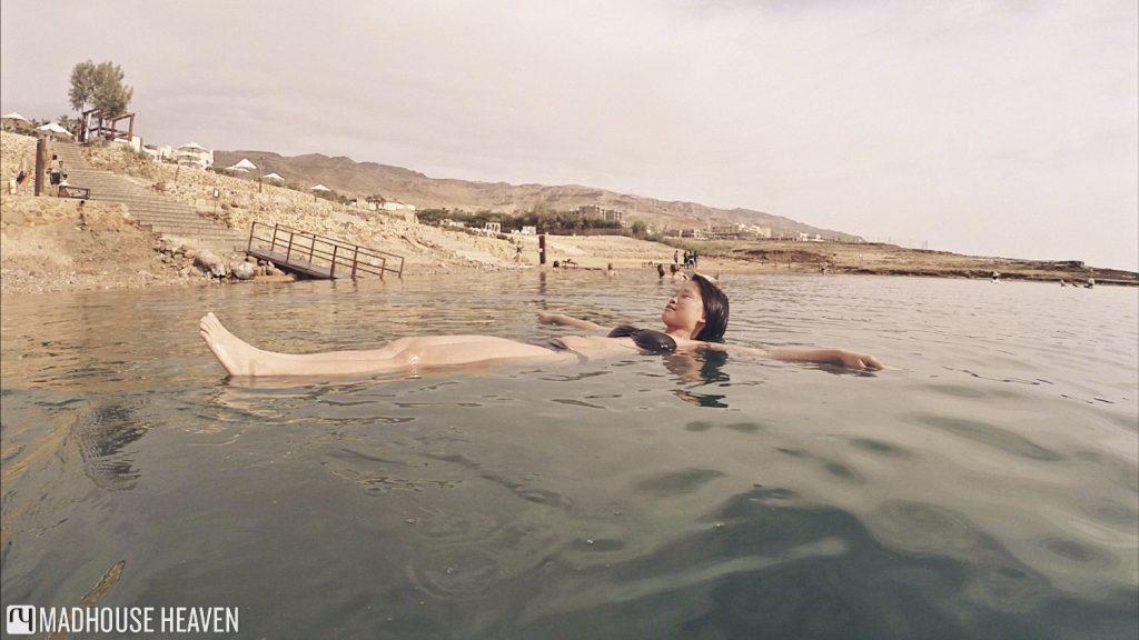 floating dead sea, asian girl, jordan, kempinski hotel