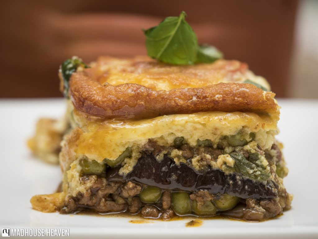 perfect slice of moussaka with grated crispy cheese