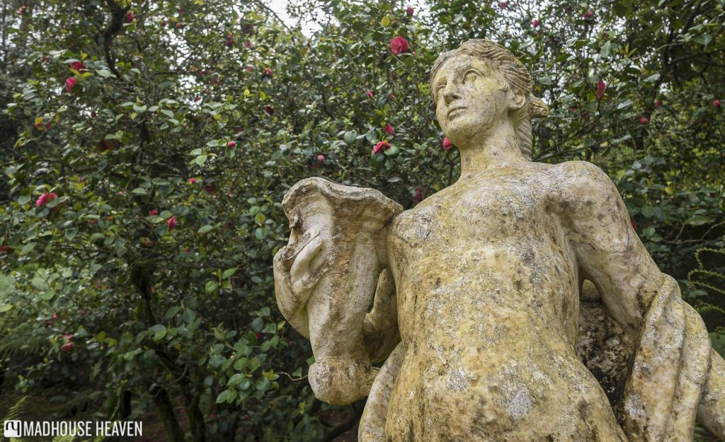 Statue of the Greek goddess Fortuna carrying a vase, in the Promenade of the Gods in Quinta da Regaleira