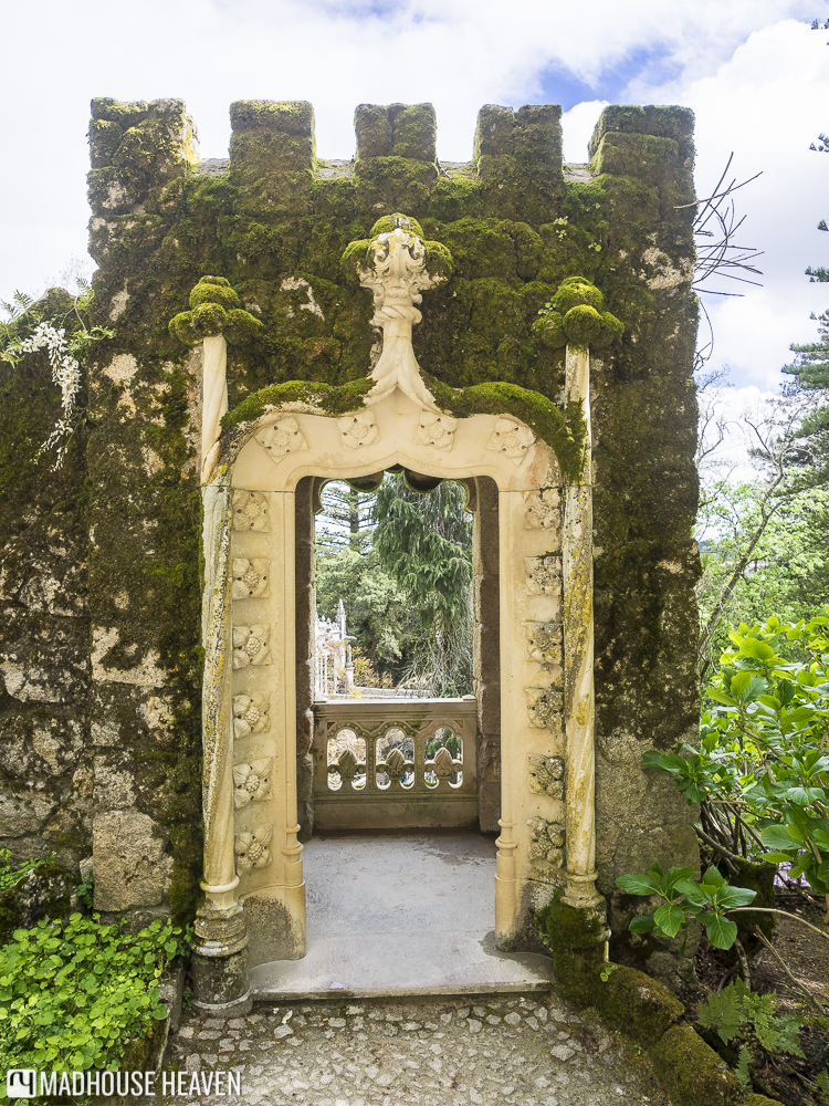 intricate carved entrance to a tower in Quinta de Regaleira