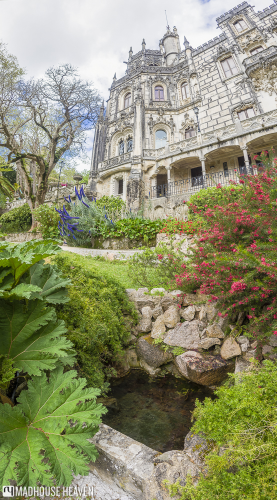 The little garden with a pond in front of the palace of Quinta da Regaleira