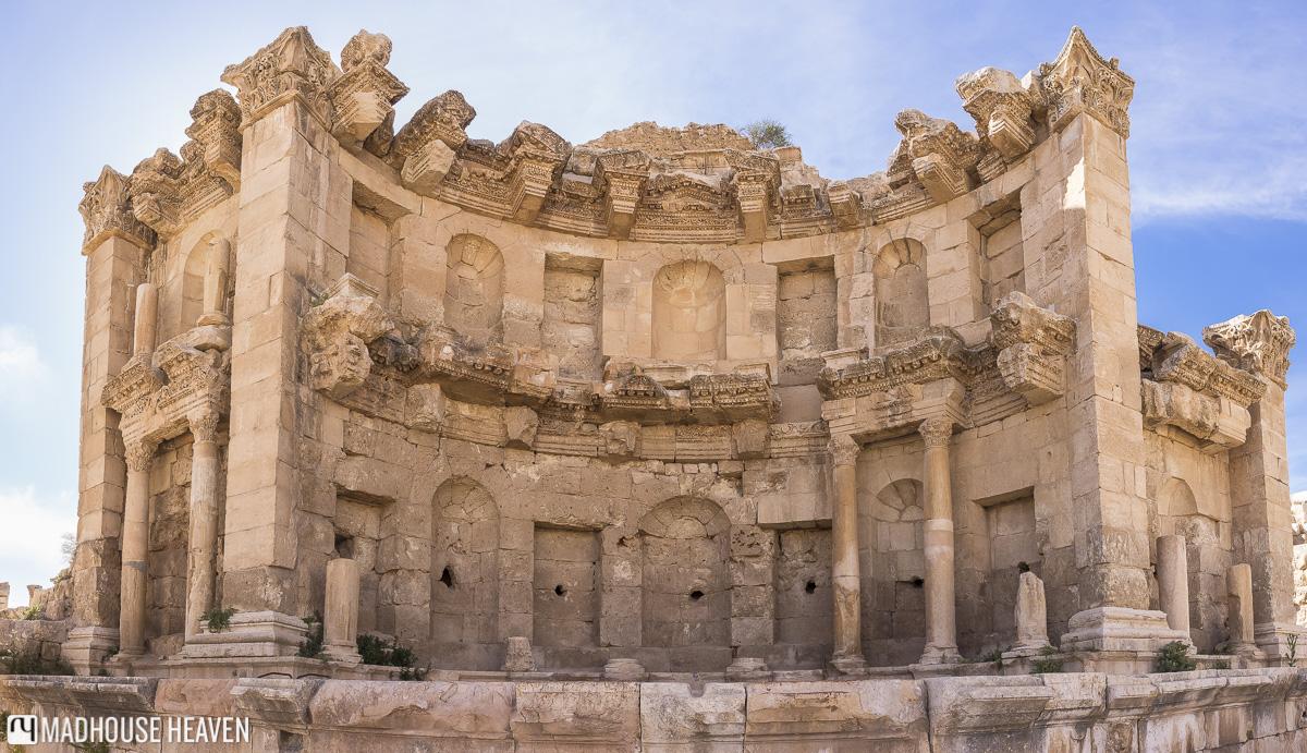 visiting jerash jordan, The Nymphaeum, roman public fountain, roman ruin, roman christian influence,