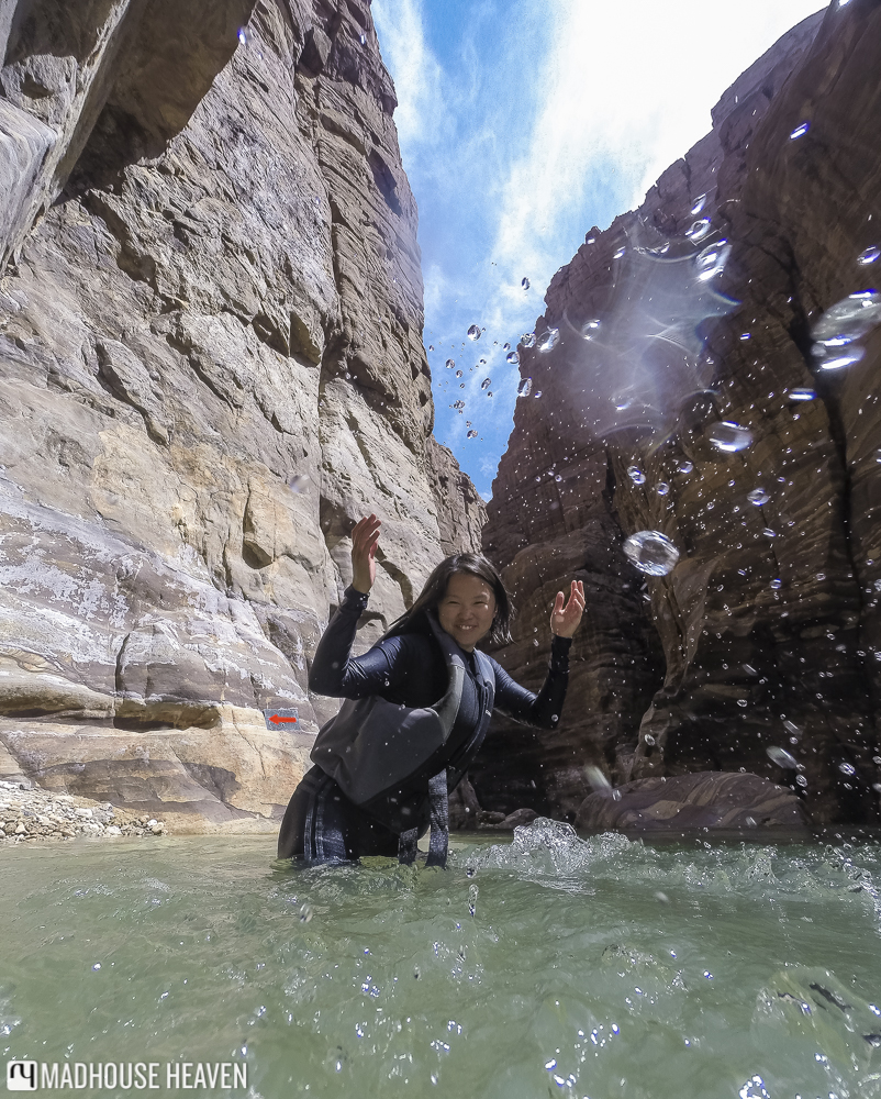 canyoning, wadi mujib, girl splashing water