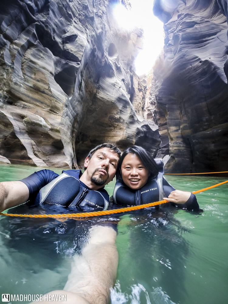 man and woman canyoning in wadi mujib siq trail, jordan