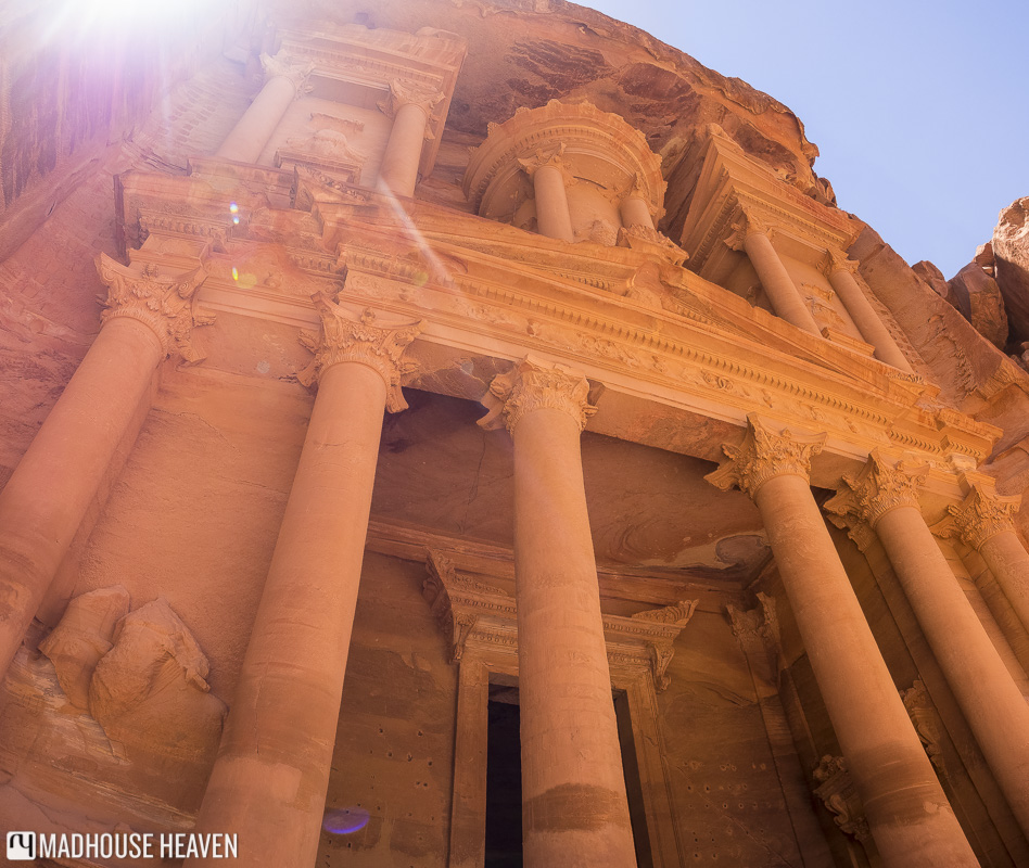 Petra's Treasury, looming above, as seen from the base of this grand tomb