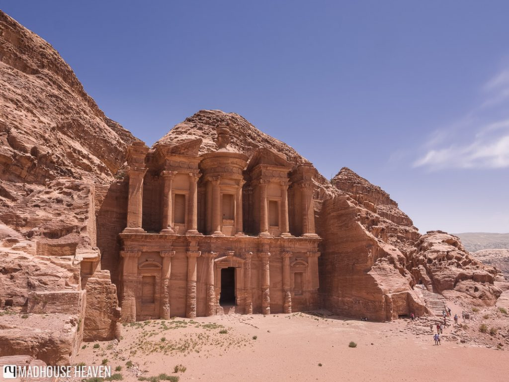The Monastery, carved into the red rock of Petra, under the bright blue sky