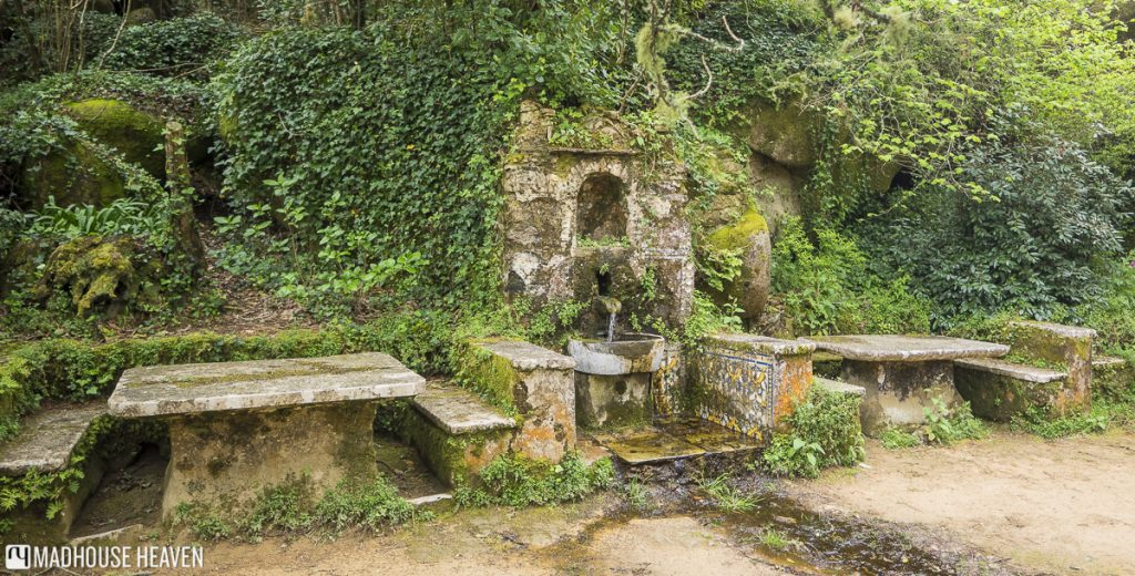 Stone tables and chairs, Monastery courtyard picnic area, Convent of the Capuchos, Franciscan cloister, Sintra, Portugal.