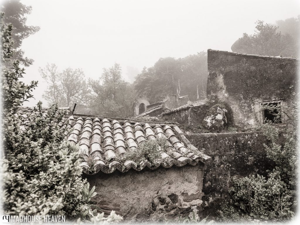 Staggered tiled rooftops, medieval monastery in the enchanted forest, convent of the capuchos,