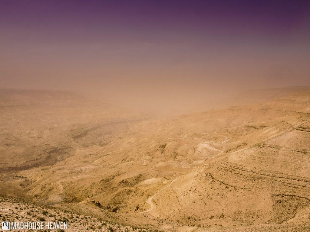 purple desert sky over wadi mujib caused by dust storm, jordan