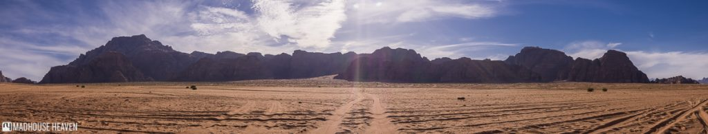 panorama of sunset in wadi rum, clear blue skies, al ghuroub, jordan