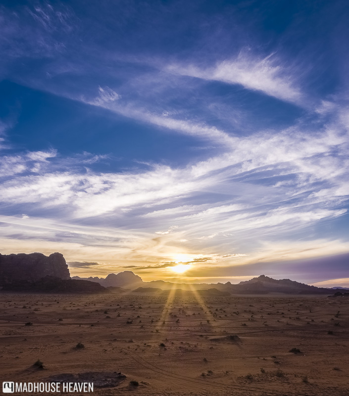 jordan travel destination, epic desert sunset in wadi rum, dramatic cirrus clouds,