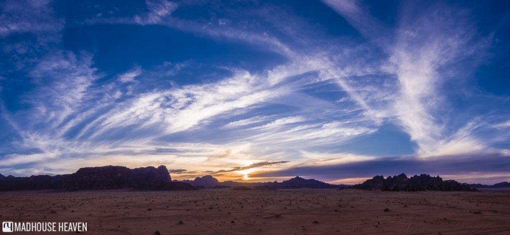 sunset over wadi rum, blue skies, cirrus clouds