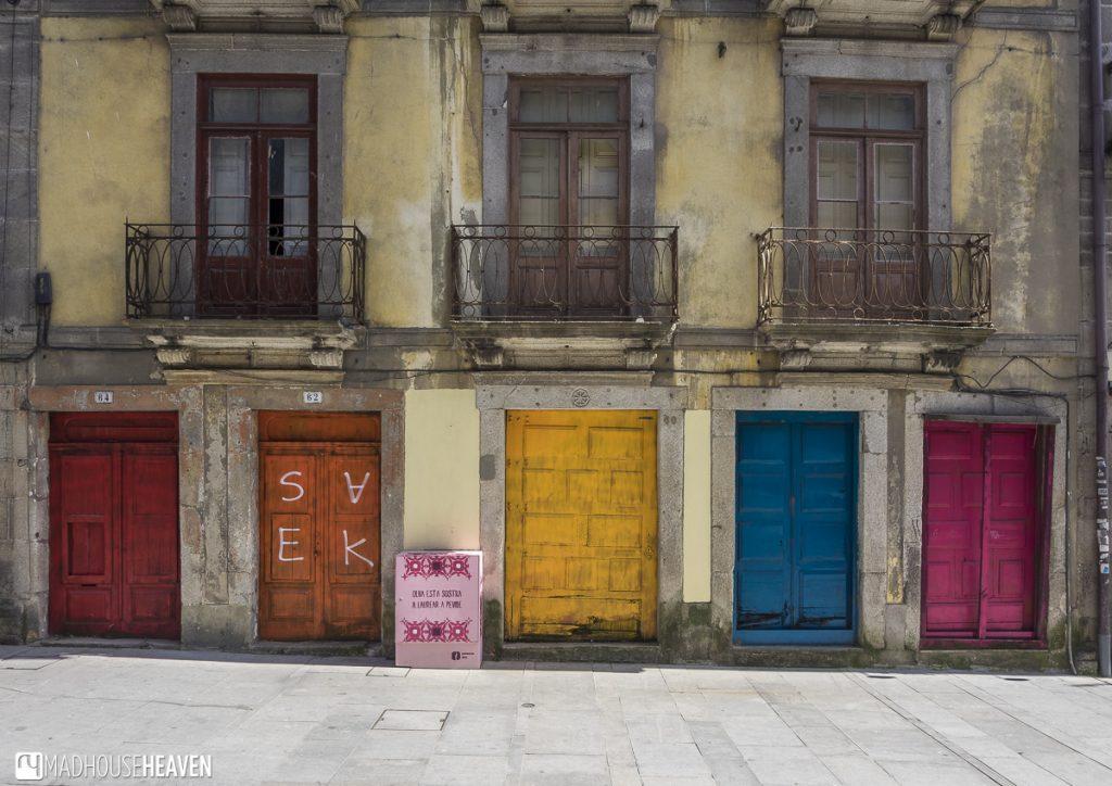 porto historical charm, colourful doors, abandoned shophouses