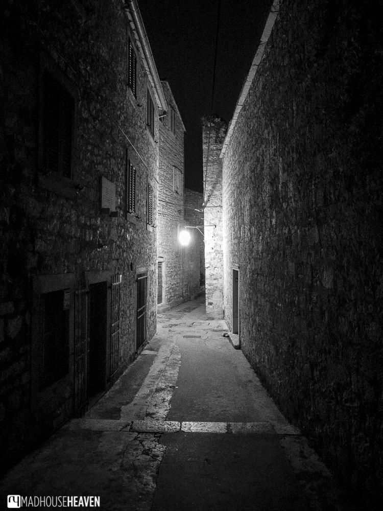 Hvar End of Season, narrow alleyway, quaint streets, silent movie, black and white