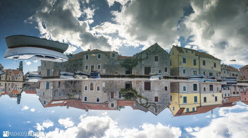 Hvar Island Tour, Stari Grad, stone houses reflected in river, surreal town landscape