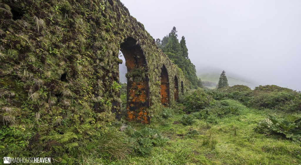 The Azores Atlantic Paradise, roman aquaduct covered in orange lichen