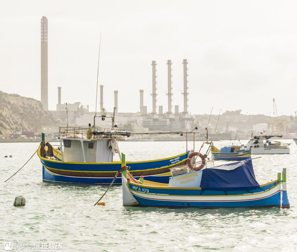 Fishing boats in front of powerplant - Marsaxlokk Market on Sunday