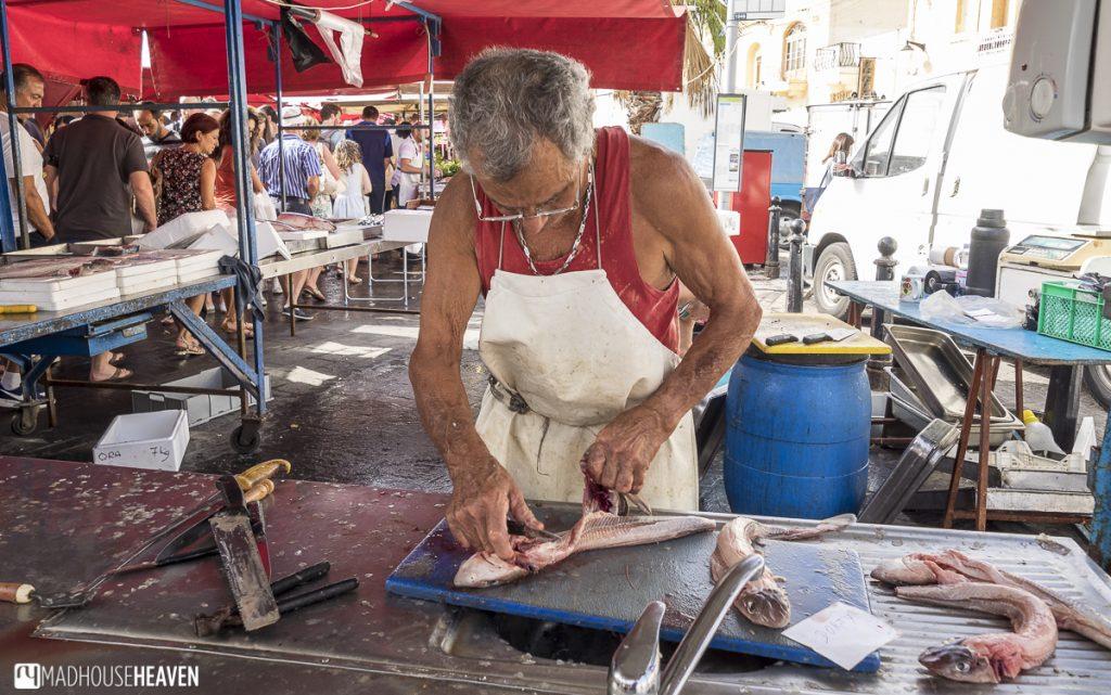 Fishmonger preparing a fish