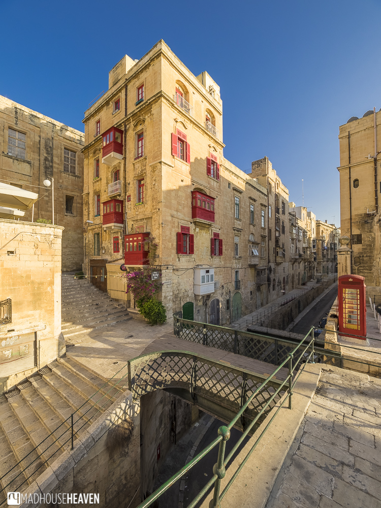 Stone houses with red balconies with European, Christian and middle-eastern influence. malta megalithic to modern