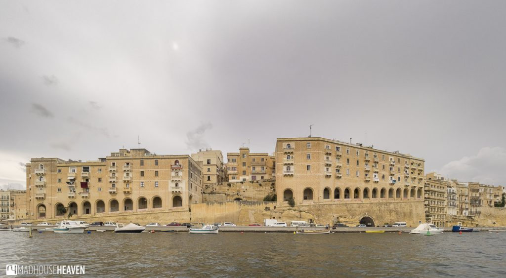 Houses on a steep slope built around the harbour of Birgu and L-Isla in Malta
