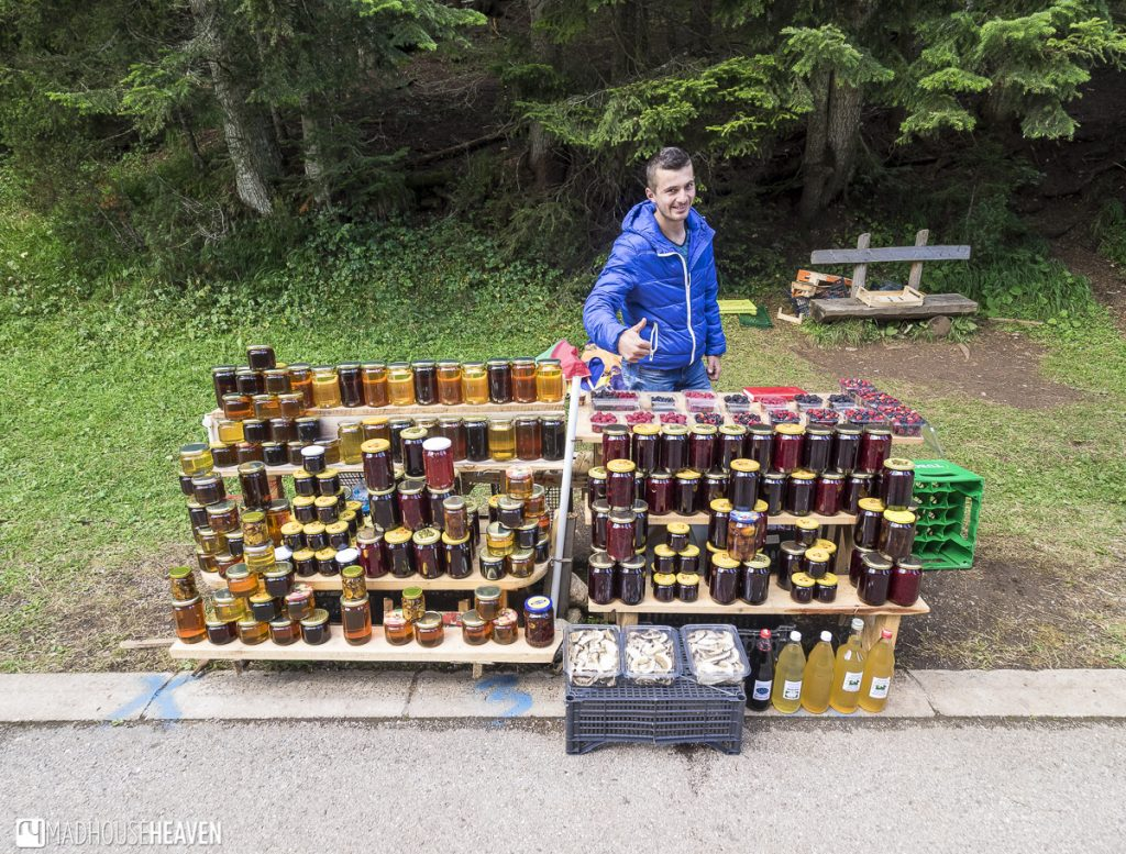Vendor at Durmitor National Park selling jars of local honey and jams made with forest fruit