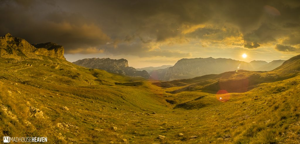 Golden sunset painting the mountain valley and peaks a pink copper colour, hike to Škrčko Lake, Durmitor mountains, Montenegro
