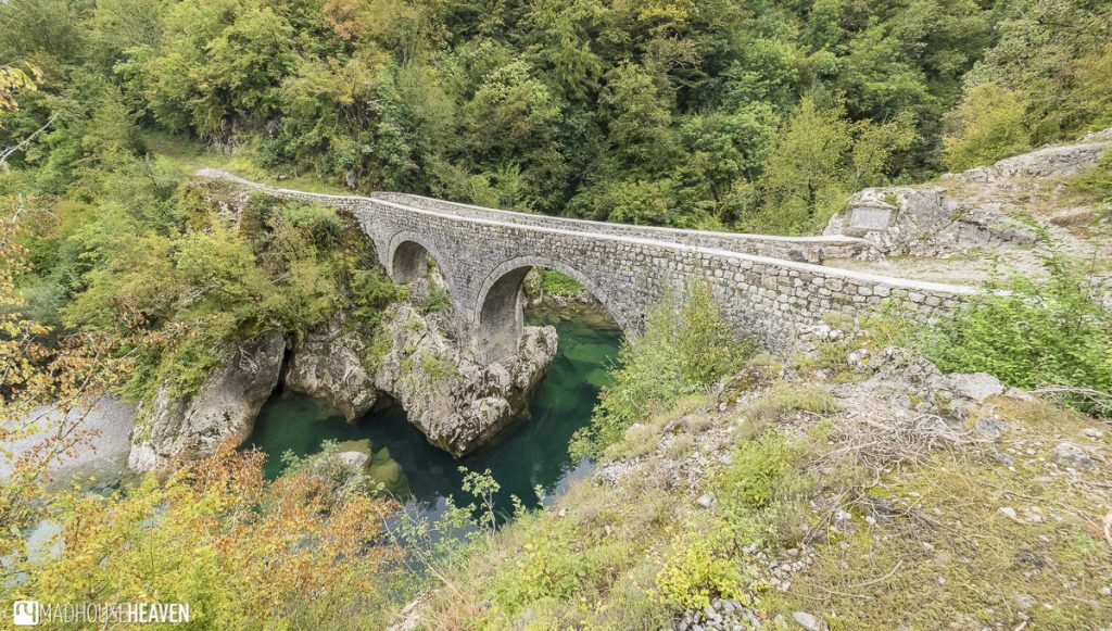 Stone bridge cutting across the Mrtvica river, bridging the canyon in Montenegro