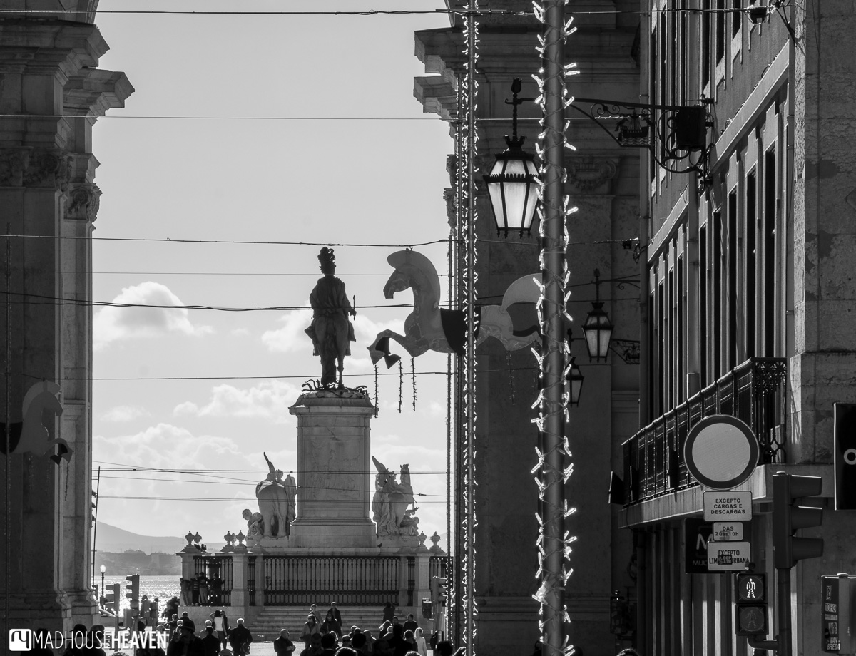 Silhouette of Statue of King Joseph I framed by European buildings Lisbon's Architectural History