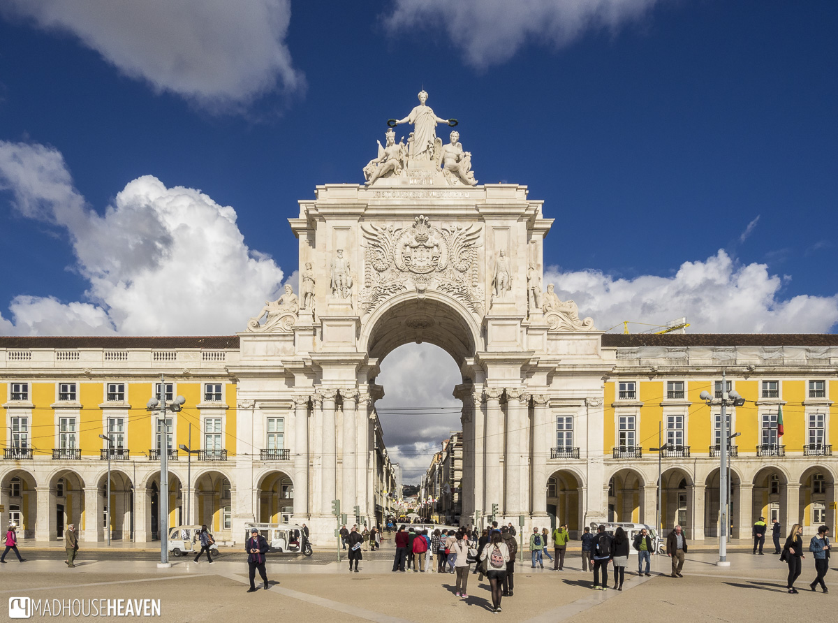 Symmetrical view of the Rua Augusta Arch in front of the commerce square, part of a tour on Lisbon's Architectural History