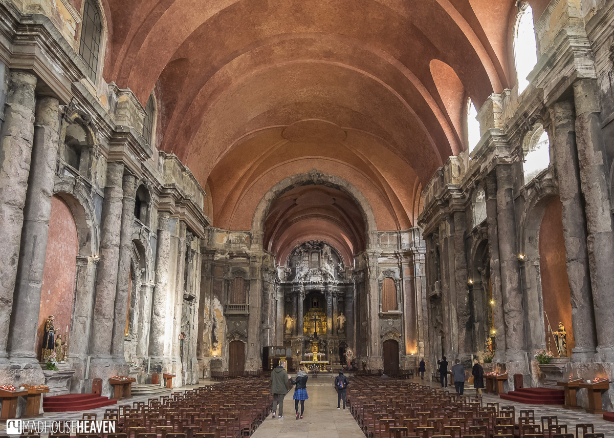 restored burnt cathedral with orange ceiling, churches in lisbon