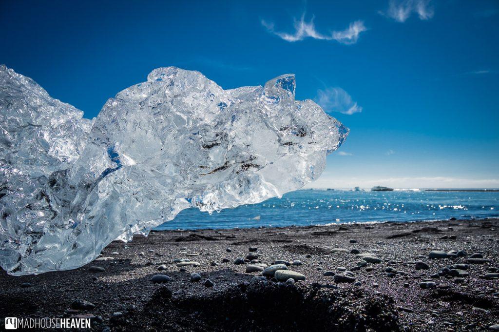 Block of ice on the black sand in the Jökulsárlón Glacier Lagoon