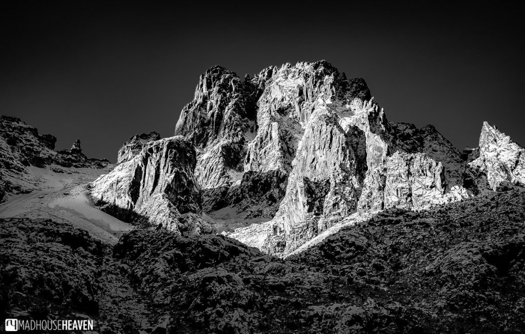 Black and white image of the peaks of Mount Kenya, beautifully framed by the shadows created by the rising sun