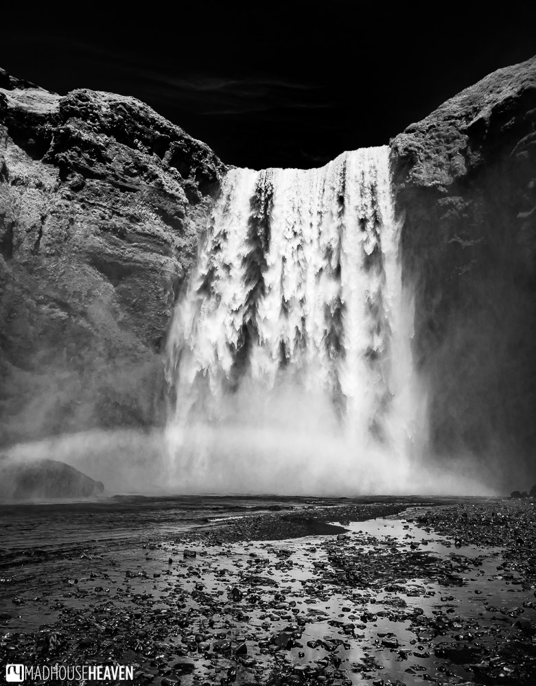 Black and white image of the Skógafoss waterfall in Iceland
