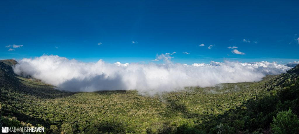 Clouds creep up the vast expanse of the Great Rift Valley on our way to Hell's Gate