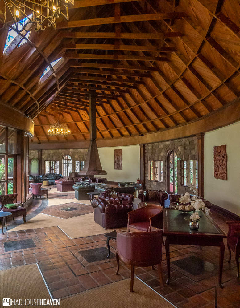 Colonial style lounge in the Lake Naivasha Sopa Lodge, with leather armchairs and a fireplace
