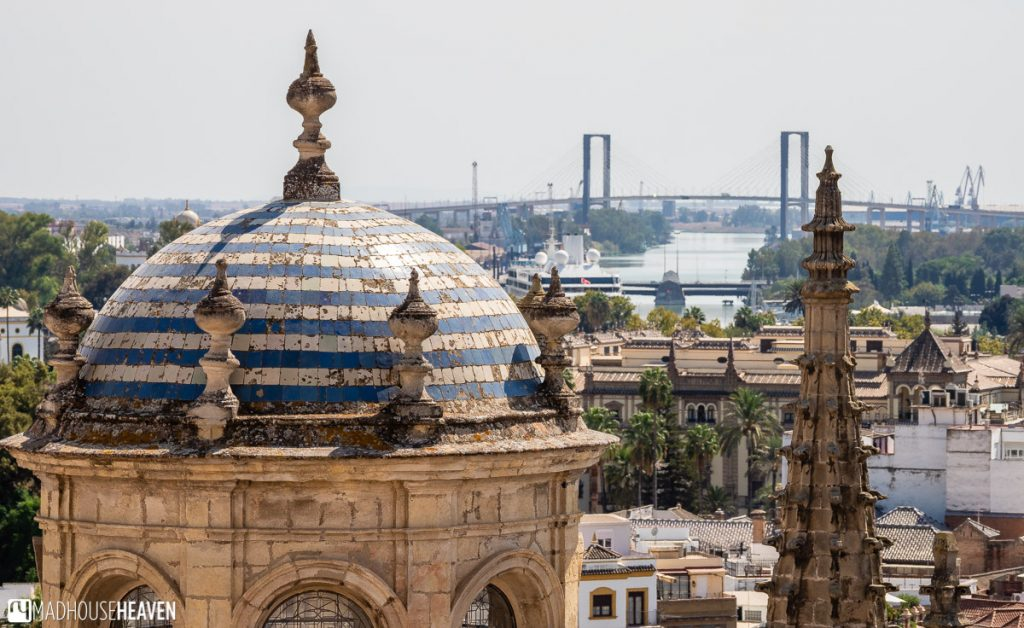 The view of one of the bridges over the Guadalquivir River and the cupola that sits atop the Renaissance Dome
