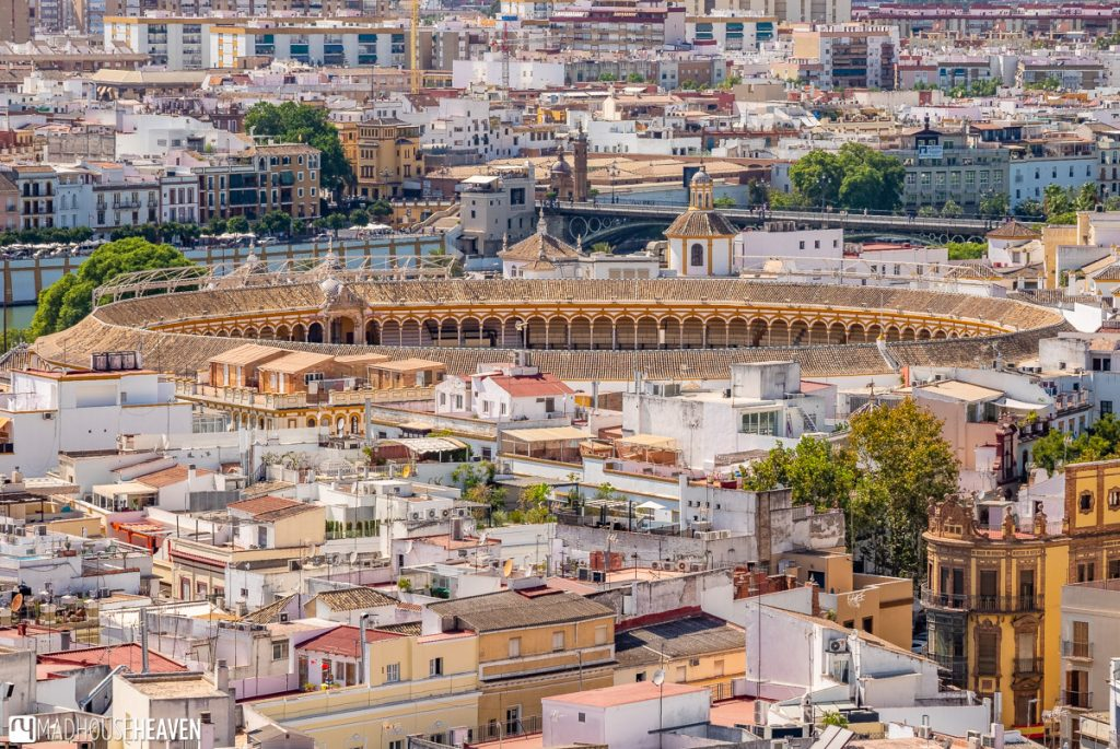 Seville's bull ring, Plaza de toros de Sevilla, looking like a pit in the middle of the city