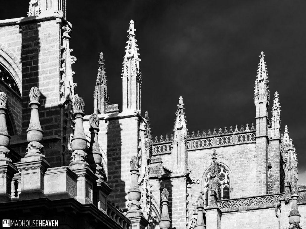Gothic pinnacles piercing the dark sky like spikes
