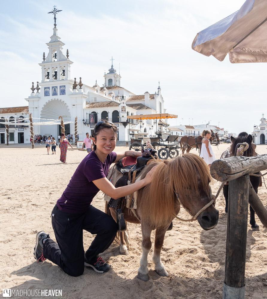 Posing with a miniature horse in El Rocio