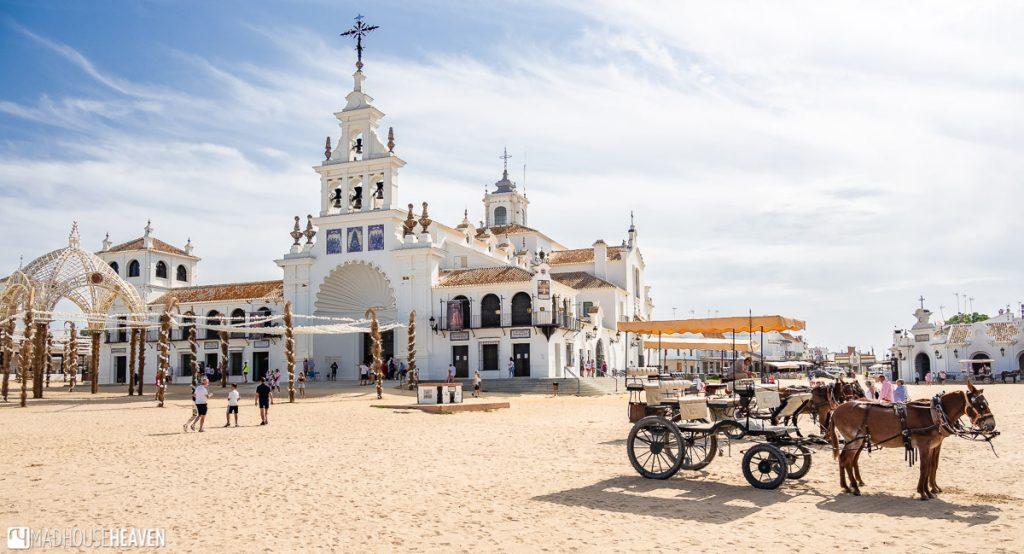 A horse drawn cart outside a church in El Rocio, in the Doñana National Park