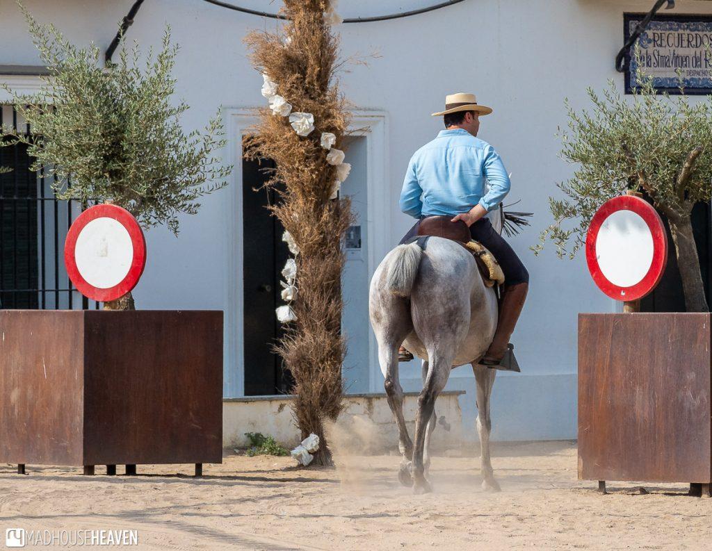 A man riding a horse in El Rocio, in the Doñana National Park