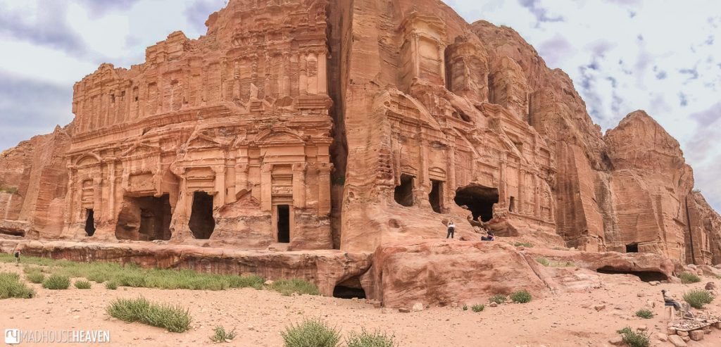 A panoramic shot of the Palace Tomb and the Corinthian Tomb, in the Valley of the Kings, inside Petra, Jordan