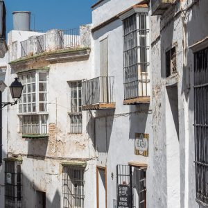 Narrow street of Arcos de la Frontera, filled with the famous white houses