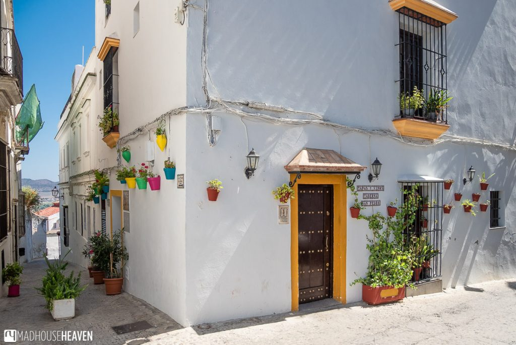 A house in Arcos de la Frontera, decorated with colourful flower pots