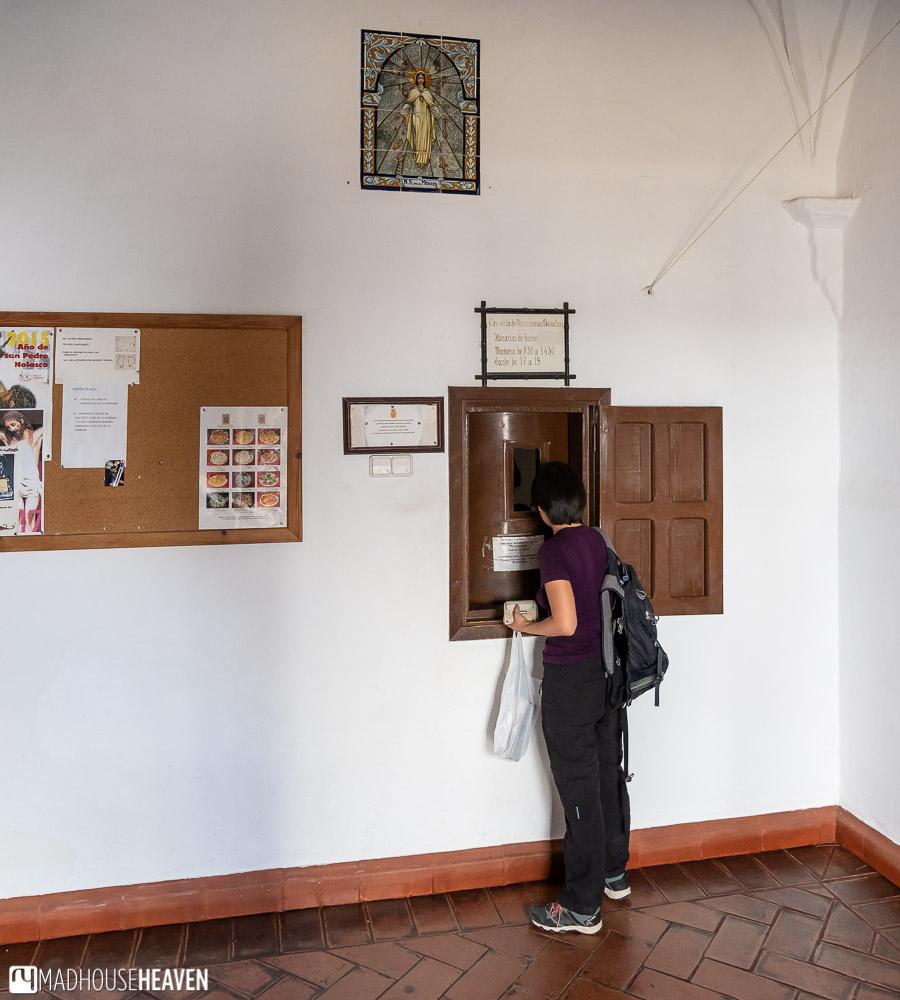 A woman buying sweets in the Comunidad de Mercedarias Descalzas Convent Bakery