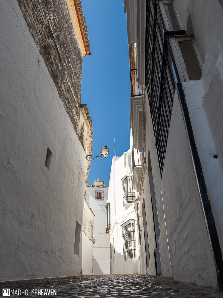Narrow cobblestone streets and white houses in Arcos de la Frontera, one of the Pueblo Blancos of Andalusia