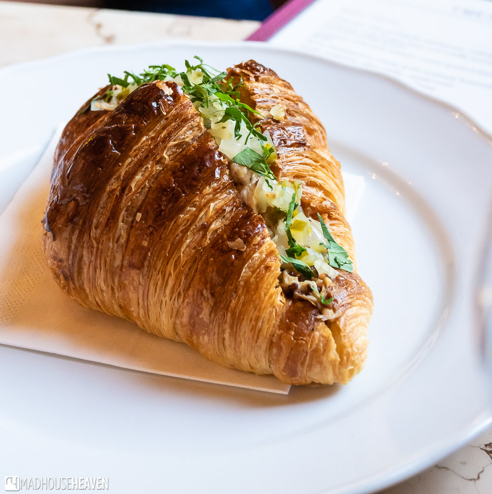 A savoury croissant stuffed with pork and herbs