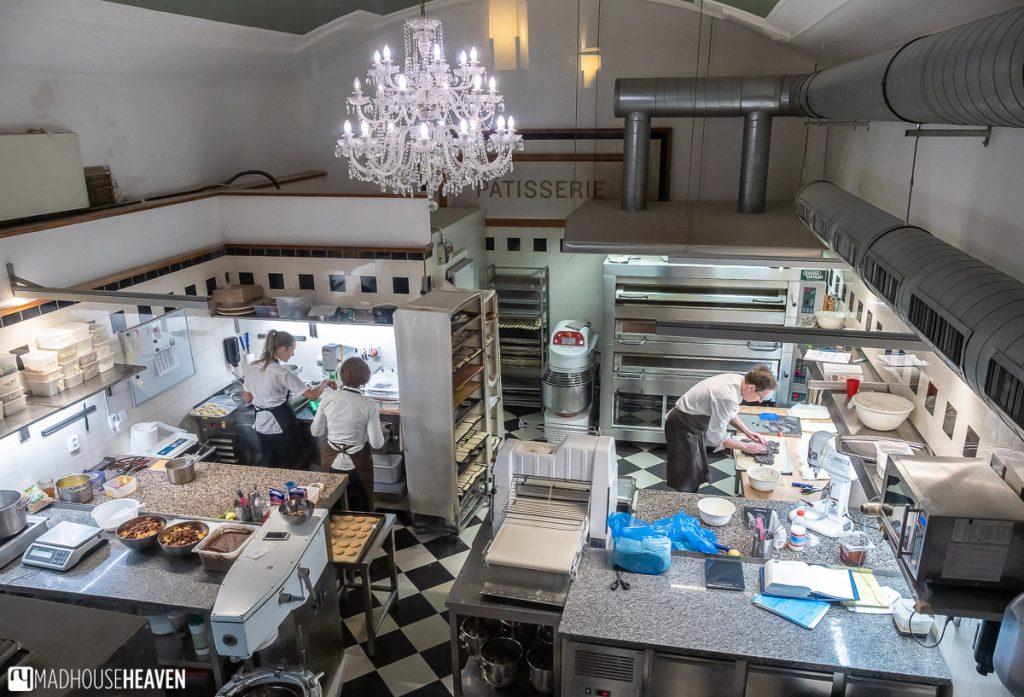 A plan view into a kitchen of a grand café