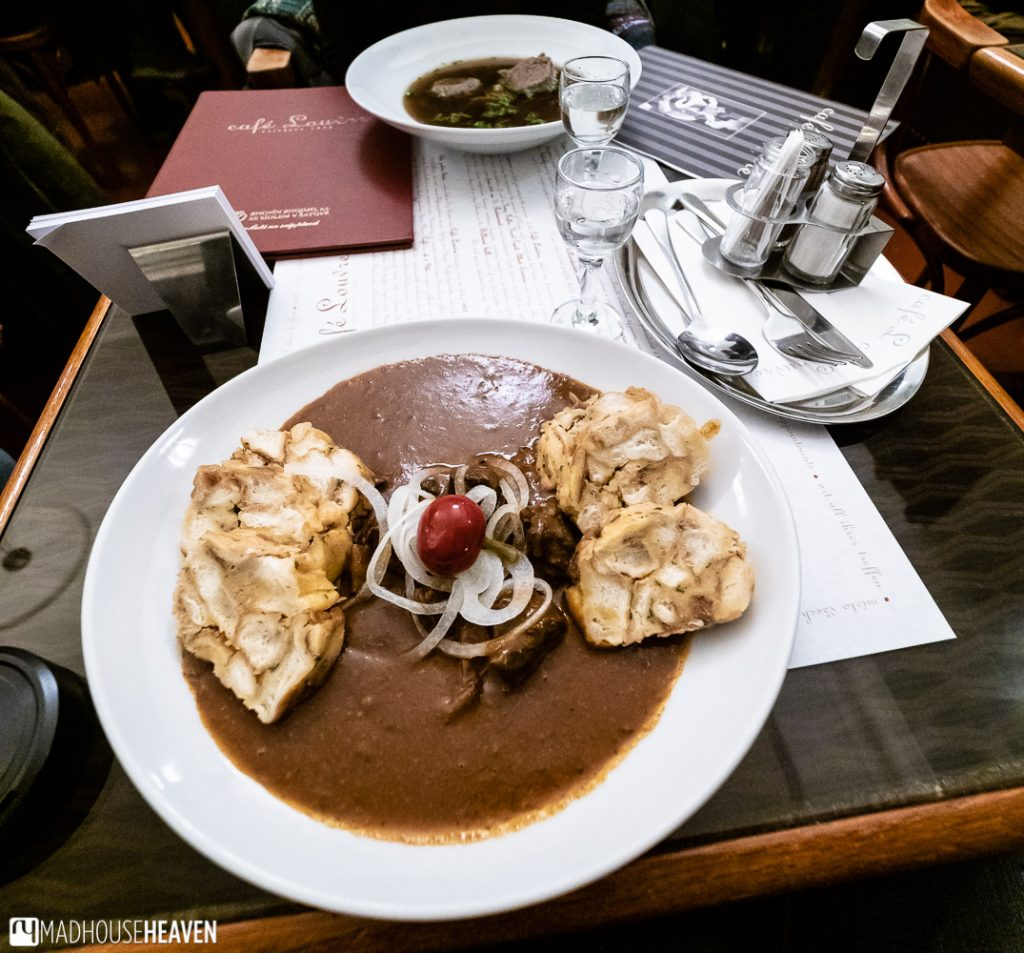 Traditional beef goulash with bread rolls