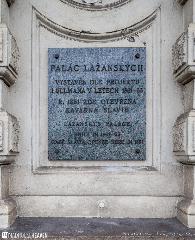 A stone plague declaring 'Café Slavia opened here in 1881'
